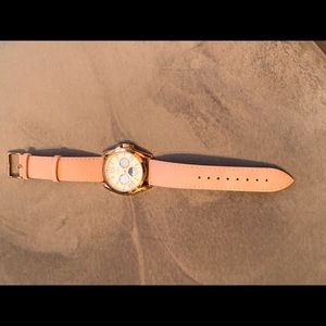 Rose gold Peugeot watch